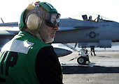 Gulf of Oman - December 11, 2008 -- President Hamid Karzai observes flight operations Thursday, December 11, 2008 aboard the Nimitz-class aircraft carrier USS Theodore Roosevelt (CVN 71). Karzai visited Theodore Roosevelt to gain a better understanding of how the United States Navy conducts operations at sea. Theodore Roosevelt and embarked Carrier Air Wing (CVW) 8 are deployed to the U.S. 5th Fleet area of responsibility. .Credit: Antwjuan Richards-Jamison - U.S. Navy via CNP.
