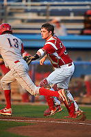 Batavia Muckdogs catcher Kolby Byrd #37 tags out Tyler Greene #13 during a NY-Penn League game against the Williamsport Crosscutters at Dwyer Stadium on August 25, 2012 in Batavia, New York.  Batavia defeated Williamsport 6-5.  (Mike Janes/Four Seam Images)