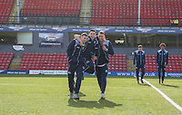 Luke O'Nien is carried by Max Muller (right) & Will De Havilland of Wycombe Wanderers ahead of the Sky Bet League 2 match between Grimsby Town and Wycombe Wanderers at Blundell Park, Cleethorpes, England on 4 March 2017. Photo by Andy Rowland / PRiME Media Images.