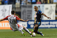 Mark Bloom (28) of Toronto FC challenges Fabio Alves (Fabinho) (33) of the Philadelphia Union for the ball. The Philadelphia Union defeated Toronto FC 1-0 during a Major League Soccer (MLS) match at PPL Park in Chester, PA, on October 5, 2013.