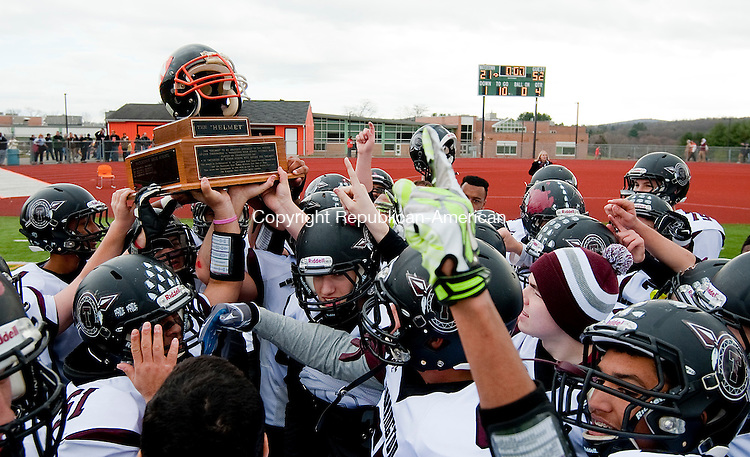 WATERTOWN, CT--- -112265JS24-Members of the Torrington football team hoist &quot;The Helmet&quot; trophy following their 52021 win over Watertown during their annual Thanksgiving day game Thursday at Watertown High School. <br /> Jim Shannon Republican-American