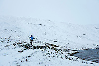 Female hiker near Llyn y Fan Fawr in winter, Black Mountain, Brecon Beacons national park, Wales