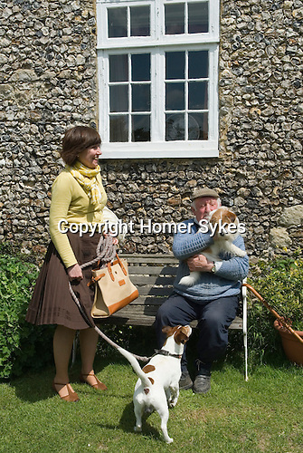 Retired farmer Huwie with his dog and Patricia with Brendan.  Charing Kent UK.