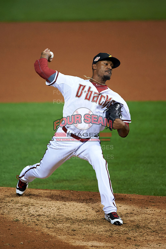 Salt River Rafters pitcher Myles Smith (52) delivers a pitch during an Arizona Fall League game against the Glendale Desert Dogs on October 22, 2015 at Salt River Fields at Talking Stick in Scottsdale, Arizona.  Glendale defeated Salt River 7-5.  (Mike Janes/Four Seam Images)