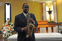 Sax Preacher plays at the funeral of housing activist Beauty Turner, 51, a one-time resident of the Robert Taylor Homes who led the Beauty Turner Ghetto Bus Tour and received national recognition in publications such as The Wall Street Journal, at the Greater Harvest Missionary Baptist Church on South State Street in Chicago, Illinois on December 26, 2008.  Turner died of an aneurysm on December 18.