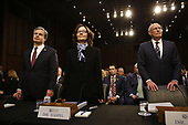 """Director Christopher Wray, Federal Bureau of Investigation (FBI), Director Gina Haspel, Central Intelligence Agency (CIA), and Director Daniel Coats, Office of the Director of National Intelligence (ODNI) stand as they testify before the United States Senate Select Committee on Intelligence during an open hearing on """"Worldwide Threats"""" on Capitol Hill in Washington, DC on Tuesday, January 29, 2019.<br /> Credit: Martin H. Simon / CNP"""