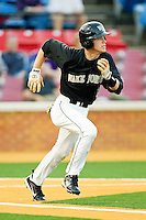Jack Fischer #15 of the Wake Forest Demon Deacons hustles down the first base line against the Miami Hurricanes at Gene Hooks Field on March 18, 2011 in Winston-Salem, North Carolina.  Photo by Brian Westerholt / Four Seam Images