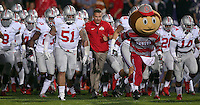 Brutus Buckeye helps lead the team onto the field prior to the NCAA football game between Ohio State and Northwestern at Ryan Field in Evanston, Illinois on Saturday, October 5, 2013. Final score: Ohio State 40, Northwestern 30. (Columbus Dispatch photo by Jonathan Quilter)