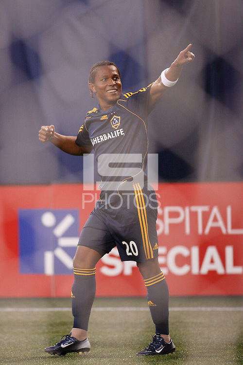 As seen through the net, Los Angeles Galaxy forward (20) Carlos Pavon celebrates scoring his second goal during an MLS regular season match against the New York Red Bulls at Giants Stadium, East Rutherford, NJ, on August 18, 2007. The Red Bulls defeated the Galaxy 5-4.