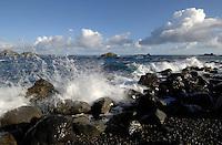 Waves crashing onto rocky sea shore, Roque de las bodegas, Tenerife, Canary Islands.