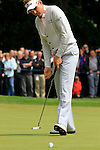 Ian Poulter (ENG) sinks his putt on the 1st green during the Final Day of the BMW PGA Championship Championship at, Wentworth Club, Surrey, England, 29th May 2011. (Photo Eoin Clarke/Golffile 2011)
