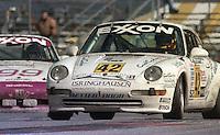 The #42 Porsche 993 Supercup of Max Schmidt, Simon Gregg, and Jarrett Freeman races to a 22nd place finish in the 24 Hours of Daytona, IMSA race, Daytona International Speedway, Daytona Beach , FL, February 4, 1996.  (Photo by Brian Cleary/www.bcpix.com)