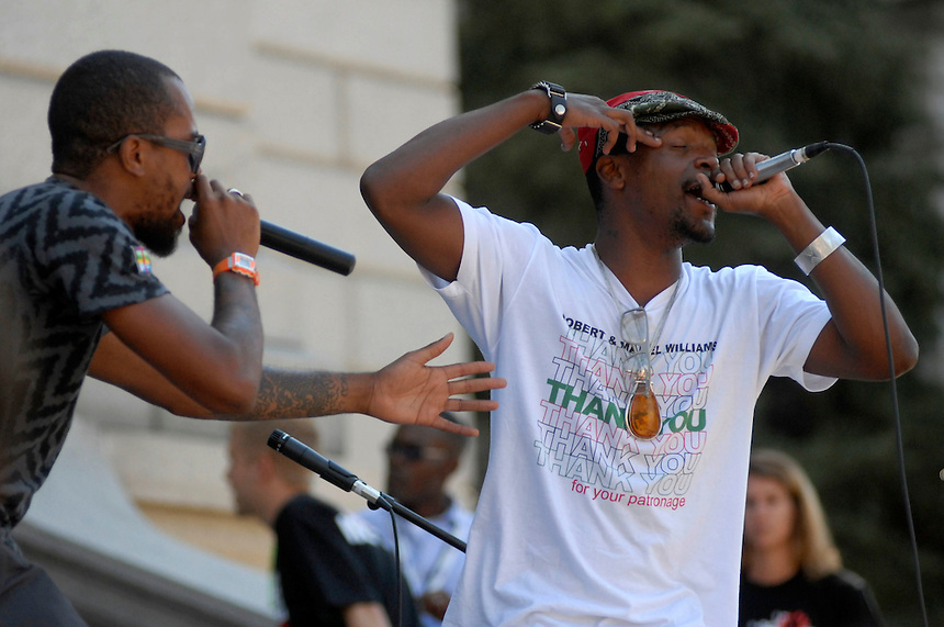 24 Aug 08: M-1 (right) and Stic.man of the hip hop duo Dead Prez performs on the steps of the Colorado state capitol building. On the day before the Democratic National Convention is scheduled to begin about 1,500 people participated in the ReCreate 68 rally, which included a march from the Colorado state capitol building to the Pepsi Center.