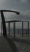Street light/Lamp and shelter on pedestrian walkway by the sea, Playa de la Caleta, El Hierro, Canary Islands