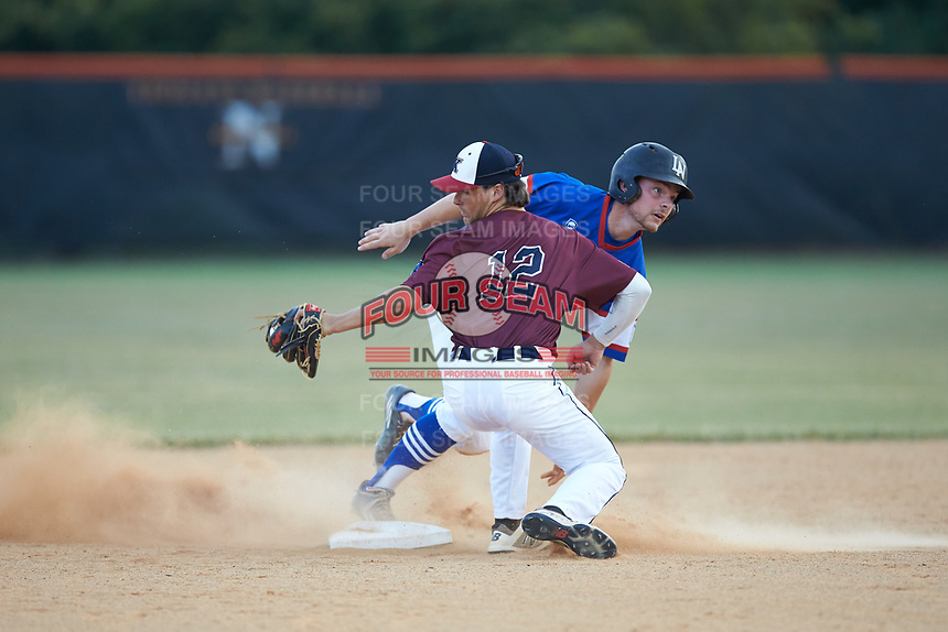Sam Crowe (15) of Mooresville Post 66 slides into second base ahead of the tag by Kannapolis Post 115 shortstop Sam Walker (12) during an American Legion baseball game at Northwest Cabarrus High School on May 30, 2019 in Concord, North Carolina. Mooresville Post 66 defeated Kannapolis Post 115 4-3. (Brian Westerholt/Four Seam Images)
