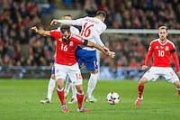 Joe Ledley of Wales clashes with Luka Milivojevic of Serbia during the FIFA World Cup Qualifying match between Wales and Serbia at the Cardiff City Stadium, Cardiff, Wales on 12 November 2016. Photo by Mark  Hawkins.