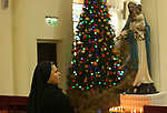 A Nun of the Missionaries of Charity order attends Christmas day mass at the Roman Catholic Church of Holy Family in Gaza City on December 25, 2016. Photo by Ashraf Amra Nuns of the Missionaries of Charity order attend Christmas day mass at the Roman Catholic Church of Holy Family in Gaza City on December 25, 2017. Photo by Ashraf Amra A nun of the Missionaries of Charity order attends Christmas day mass at the Roman Catholic Church of Holy Family in Gaza City on December 25, 2017. Photo by Ashraf Amra