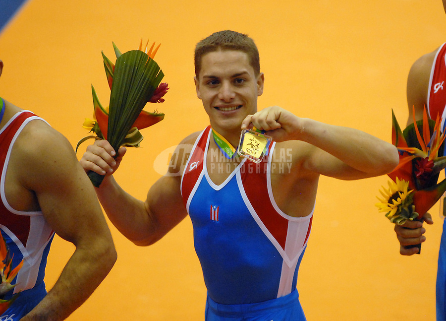 Jul 14, 2007; Rio de Janeiro, Brazil; Reinaldo Oquendo Flores (PUR) shows off his gold medal after the mens team qualification final in the Pan American Games at the Multipurpose Arena in Rio de Janeiro. Mandatory Credit: Mark J. Rebilas-US PRESSWIRE Copyright © 2007 Mark J. Rebilas