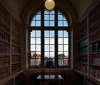 Bookshelves and window in the Campus Library, inaugurated in 1936, with 50,000 books and 150 reading desks, in the Maison Internationale or International House, designed by Lucien Bechmann, 1880-1968, and Jean-Frederic Larson, and opened in 1936, in the Cite Internationale Universitaire de Paris, in the 14th arrondissement of Paris, France. The CIUP or Cite U was founded in 1925 after the First World War by Andre Honnorat and Emile Deutsch de la Meurthe to create a place of cooperation and peace amongst students and researchers from around the world. It consists of 5,800 rooms in 40 residences, accepting another 12,000 student residents each year. Picture by Manuel Cohen. Further clearances may be requested.