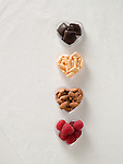 Heart healthy foods and vitamins in heart shaped containers