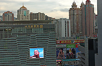 A big television screen & some adverts at the Kingglory plaza in Shenzhen, south China..