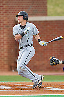 Zach Remillard (7) of the Coastal Carolina Chanticleers follows through on his swing against the High Point Panthers at Willard Stadium on March 14, 2014 in High Point, North Carolina.  The Panthers defeated the Chanticleers 3-0.  (Brian Westerholt/Four Seam Images)