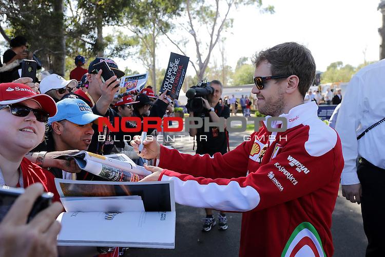 20.03.2016. Albert-Park-Circuit, Melbourne,  AUS, F1, Formula 1 Rolex Australien Grand Prix,  Race01 im Bild   <br /> Sebastian Vettel (GER#5), Scuderia Ferrari schreibt Autogramme f&uuml;r die Fans<br /> <br /> <br /> Foto &copy; nordphoto /  Bratic