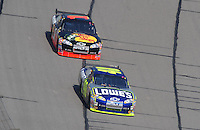 Sept. 28, 2008; Kansas City, KS, USA; Nascar Sprint Cup Series driver Jimmie Johnson (48) leads Martin Truex Jr (1) during the Camping World RV 400 at Kansas Speedway. Mandatory Credit: Mark J. Rebilas-