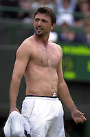 "WIMBLEDON CHAMPIONSHIPS 2001 29/06/01 GORAN IVANISEVIC (CROATIA) PERFORMS HIS TRADEMARK ""STRIPTEASE""  AFTER BEATING ANDY RODDICK (USA) PHOTO ROGER PARKER"