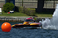 Regates de Valleyfield, 6-8 July,2001 Salaberry de Valleyfield, Quebec, Canada.Copyright©F.Peirce Williams 2001.Frame 1; CE-222, 5 Litre class hydroplane, races into turn two hops once and hooks to the left, digs in with the left side and flips over. With help from the rescue team the driver climbs out trough the bottom hatch unhurt...F. Peirce Williams .photography.P.O.Box 455  Eaton, OH 45320.p: 317.358.7326  e: fpwp@mac.com
