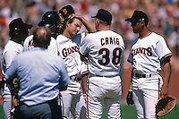 SAN FRANCISCO, CA - Dave Dravecky of the San Francisco Giants is visited at the mound by manager Roger Craig and Will Clark during a game at Candlestick Park in San Francisco, California in 1987. Photo by Brad Mangin