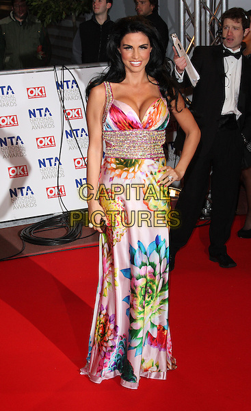 JORDAN - KATIE PRICE.The 15th National Television Awards held at the O2 Arena, London, England. .January 20th, 2010 .NTA NTAs full length maxi dress pink beaded diamante jewel encrusted multi-coloured print floral pattern silk satin blue white green hand on hip.CAP/ROS.©Steve Ross/Capital Pictures.