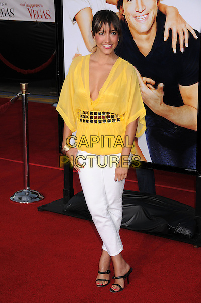 "FERNANDA ROMERO.""What Happens in Vegas"" Los Angeles Premiere at Mann's Village Theatre, Westwood, California, USA..May 1st, 2008.full length yellow top white trousers cropped belt detail waist sheer low cut plunging neckline .CAP/ADM/BP.©Byron Purvis/AdMedia/Capital Pictures."