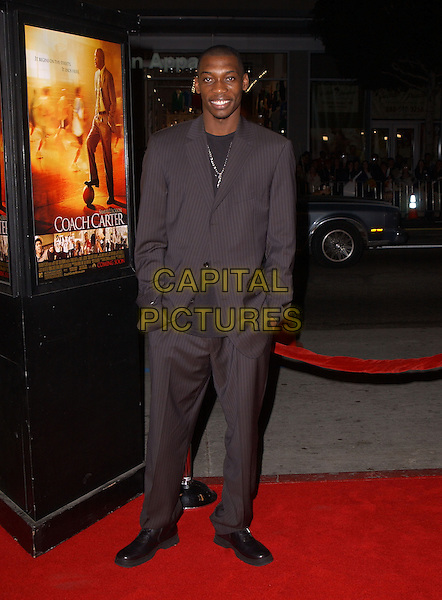 "NANA GBEWONYA.Paramount Pictures' L.A. Premiere of ""Coach Carter"" held at The Grauman's Chinese Theatre in Hollywood, California .January 13th, 2005 .full length, hands in pockets, grey,gray pinstripe suit.www.capitalpictures.com.sales@capitalpictures.com.Supplied By Capital PIctures"