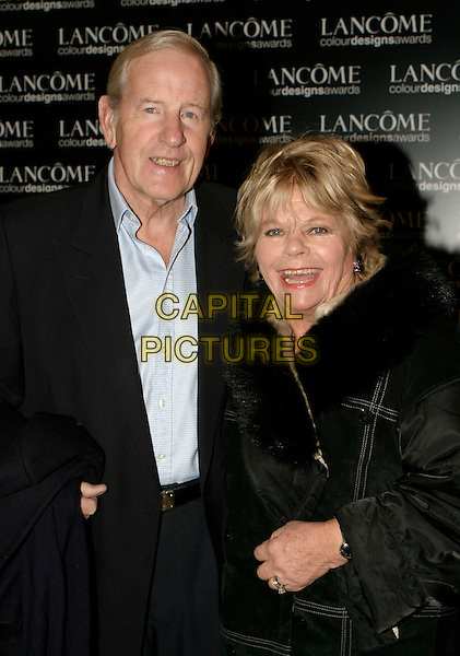 JUDITH CHALMERS & GUEST.Lancome Colour Design Awards 2005 at Freemason's Hall, London, UK..November 23rd, 2005.Ref: AH.half length black fur trim.www.capitalpictures.com.sales@capitalpictures.com.© Capital Pictures.