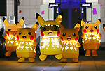 """August 8, 2019, Yokohama, Japan - Nintendo's videogame software Pokemon's famous character Pikachu wearing LED illuminations perform for their night show """"Pikachu Outbreak 2019"""" in Yokohama, suburban Tokyo on Thursday, August 8, 2019. 2 million people are expecting to visit the week long event.    (Photo by Yoshio Tsunoda/AFLO)"""