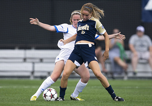 September 01, 2013:  Notre Dame forward Anna Maria Gilbertson (6) and UCLA midfielder Jenna Richmond (7) battle for the ball during NCAA Soccer match between the Notre Dame Fighting Irish and the UCLA Bruins at Alumni Stadium in South Bend, Indiana.  UCLA defeated Notre Dame 1-0.