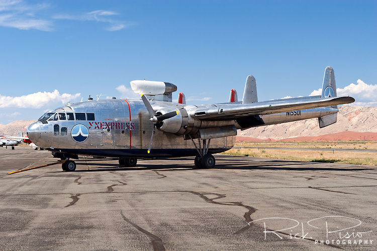 "The movie star of the Hawkins and Powers fleet sits on the tarmac in Greybull, Wyoming prior to auction in August of 2006. C119 Flying Boxcar N15501 was used to film the opening sequences of the remake of the movie ""Flight of the Phoenix."""