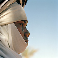 Profile of Tuareg Tribesman and flies, Libya