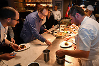 MELBOURNE, 30 June 2017 – Joe Vargetto, Philippe Mouchel and Scott Pickett prepare a dish of duo of beef wagyu, pomme soufflé, cime di rapa and sauce Périgueux at a dinner celebrating Philippe Mouchel's 25 years in Australia with six chefs who worked with him in the past at Philippe Restaurant in Melbourne, Australia.