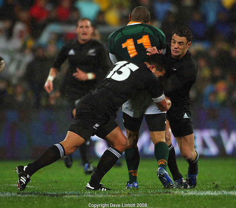 Dan Carter and Mils Muliaina tackle Bryan Habana..Philips Tri Nations, All Blacks vs South Africa at Westpac Stadium, Wellington, New Zealand, Saturday 5 July 2008. Photo: Dave Lintott/lintottphoto.co.nz