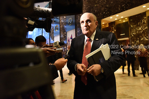 Former Mayor Rudy Giuliani (Republican of New York) speaks with members of the media in the lobby of the Trump Tower in New York, New York on November 22, 2016. <br /> Credit: Anthony Behar / Pool via CNP