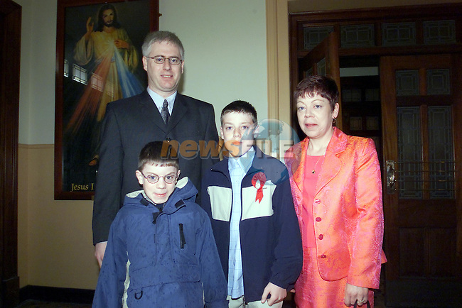 Sean Donnach with his brother Aaron and parents paul and catherine after confirmation in the Lourdes church..Picture Fran Caffrey Newsfile...This Picture is sent to you by:..Newsfile Ltd.The View, Millmount Abbey, Drogheda, Co Louth, Ireland..Tel: +353419871240.Fax: +353419871260.GSM: +353862500958.ISDN: +353419871010.email: pictures@newsfile.ie.www.newsfile.ie