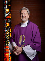 NWA Democrat-Gazette/BEN GOFF -- 03/05/15 The Rev. Roger Joslin, Vicar of All Saints' Episcopal Church of Bentonville, poses for a photo in the church the congregation shares with Christ the King Lutheran Church in Bentonville on Thursday Mar. 5, 2015.