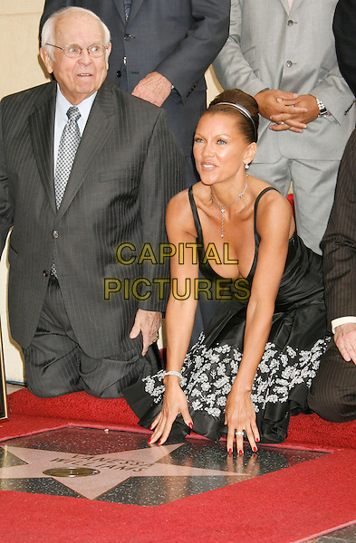 JOHNNY GRANT & VANESSA L. WILLIAMS.Vanessa Williams Celebrates Her Birthday With a Star On The Hollywood Walk of Fame, Holllywood, California, USA..March 19th, 2007 .full length black dress floral print kneeling grey gray suit plaque cleavage funny.CAP/ADM/RE.©Russ Elliot/AdMedia/Capital Pictures