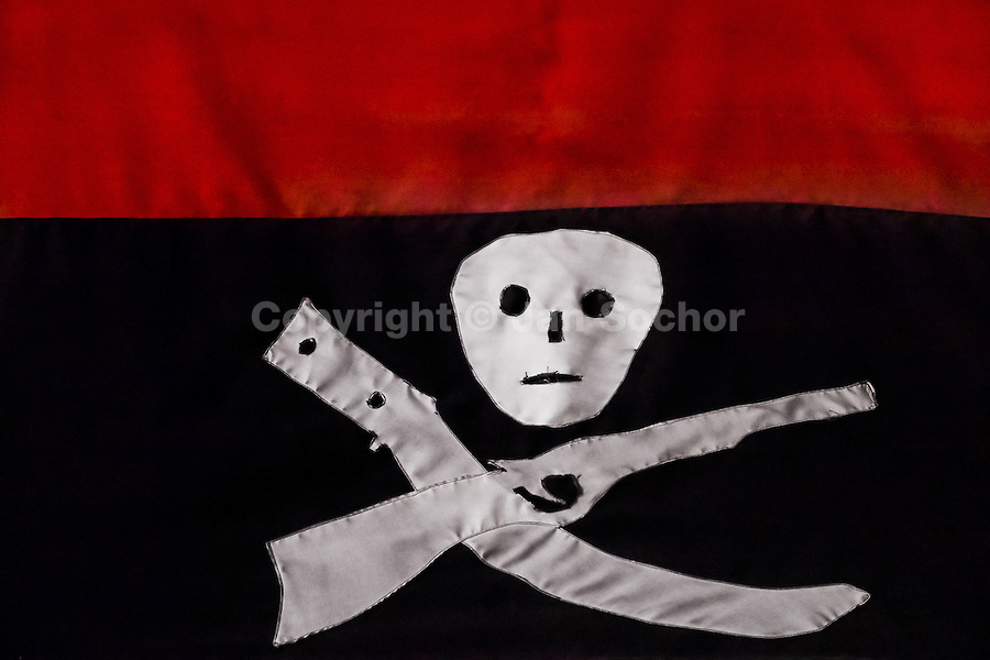 The black-and-red flag of the FSLN, having symbols of death, a rifle and a machete, displayed on the wall of the Sandinista museum in Leon, Nicaragua, 12 November 2004. The Sandinista National Liberation Front (in Spanish: Frente Sandinista de Liberación Nacional, or FSLN) is a socialist political party in Nicaragua. The FSLN is one of Nicaragua's two leading parties. Sandinistas took their name from Augusto César Sandino (1895-1934), the historical leader of Nicaragua's nationalist rebellion against the US occupation of the country in the 1930s. In 1979 the FSLN overthrew the Somoza dynasty and ruled Nicaragua from 1979 to 1990. They left power in 1990 after free elections. In 2006, the former President Daniel Ortega, the leader of the party, was re-elected President of Nicaragua.