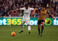 (L-R) Kyle Naughton of Swansea is challenged by Alexis Sanchez of Arsenal during the Barclays Premier League match between Swansea City and Arsenal at the Liberty Stadium, Swansea on October 31st 2015