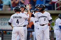 Pensacola Blue Wahoos Tanner English (4) celebrates with Jaylin Davis (5), Ernie De La Trinidad (25), Alex Kirilloff (19), and Travis Blankenhorn (32) after hitting a home run during a Southern League game against the Biloxi Shuckers on May 3, 2019 at Admiral Fetterman Field in Pensacola, Florida.  Pensacola defeated Biloxi 10-8.  (Mike Janes/Four Seam Images)