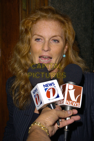 """SARAH FERGUSON, DUCHESS OF YORK.arrivals at book launch of """"Confessions of a Serial Womaniser"""" by Zerbanoo Gifford, at the National Portrait Gallery.20th September London, England.half length fergie microphone microphones giving interview.CAP/CAN.©Can Nguyen/Capital Pictures"""