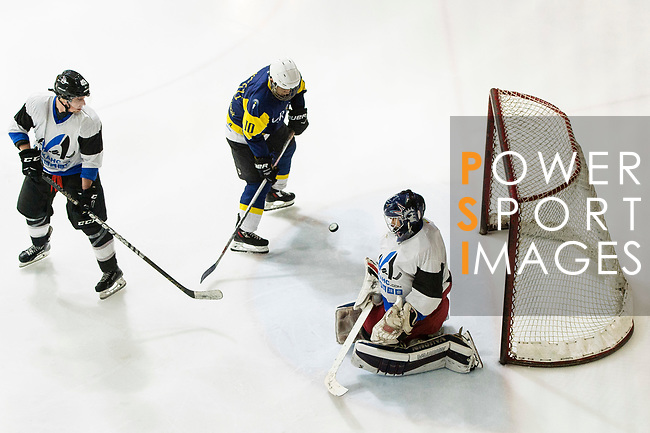 Gaggia Empire Goalkeeper #01 Rex Kong (right) defends his goal against Verity Skater #10 Art Tam (center) during the match Gaggia Empire vs Verity, a match part of the Principal Standard League on 07 March 2017 in Mega Ice, Hong Kong, China. Photo by Marcio Rodrigo Machado / Power Sport Images